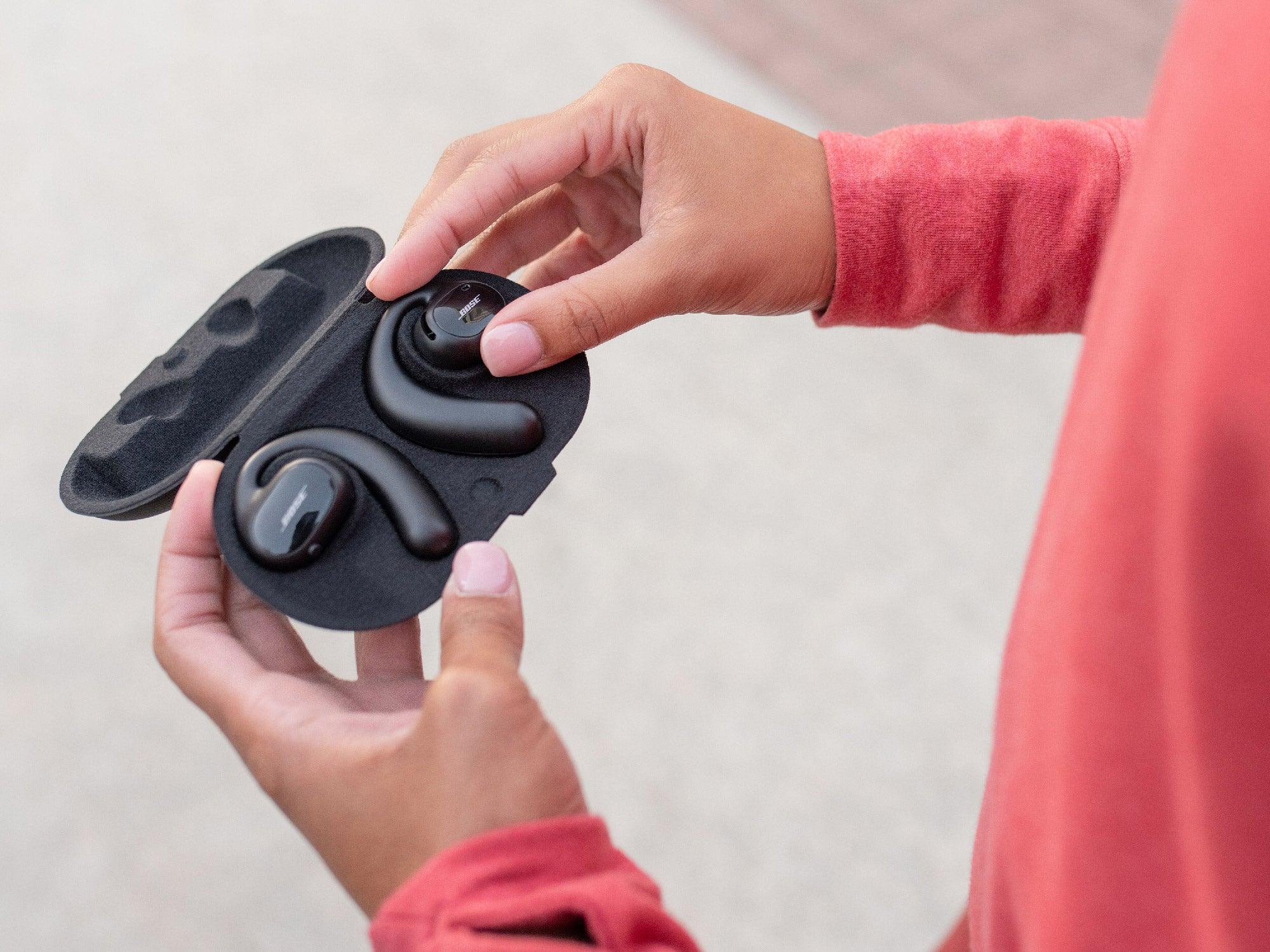 Bose Open Sport Wireless Earbuds in their case.