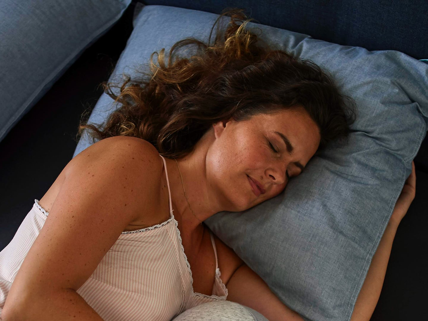 Person sleeping peacefully in bed