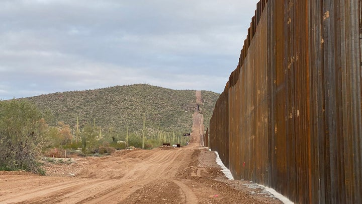 The Trump border wall made of concrete and steel on the edge of Organ Pipe Cactus National Monument in Arizona