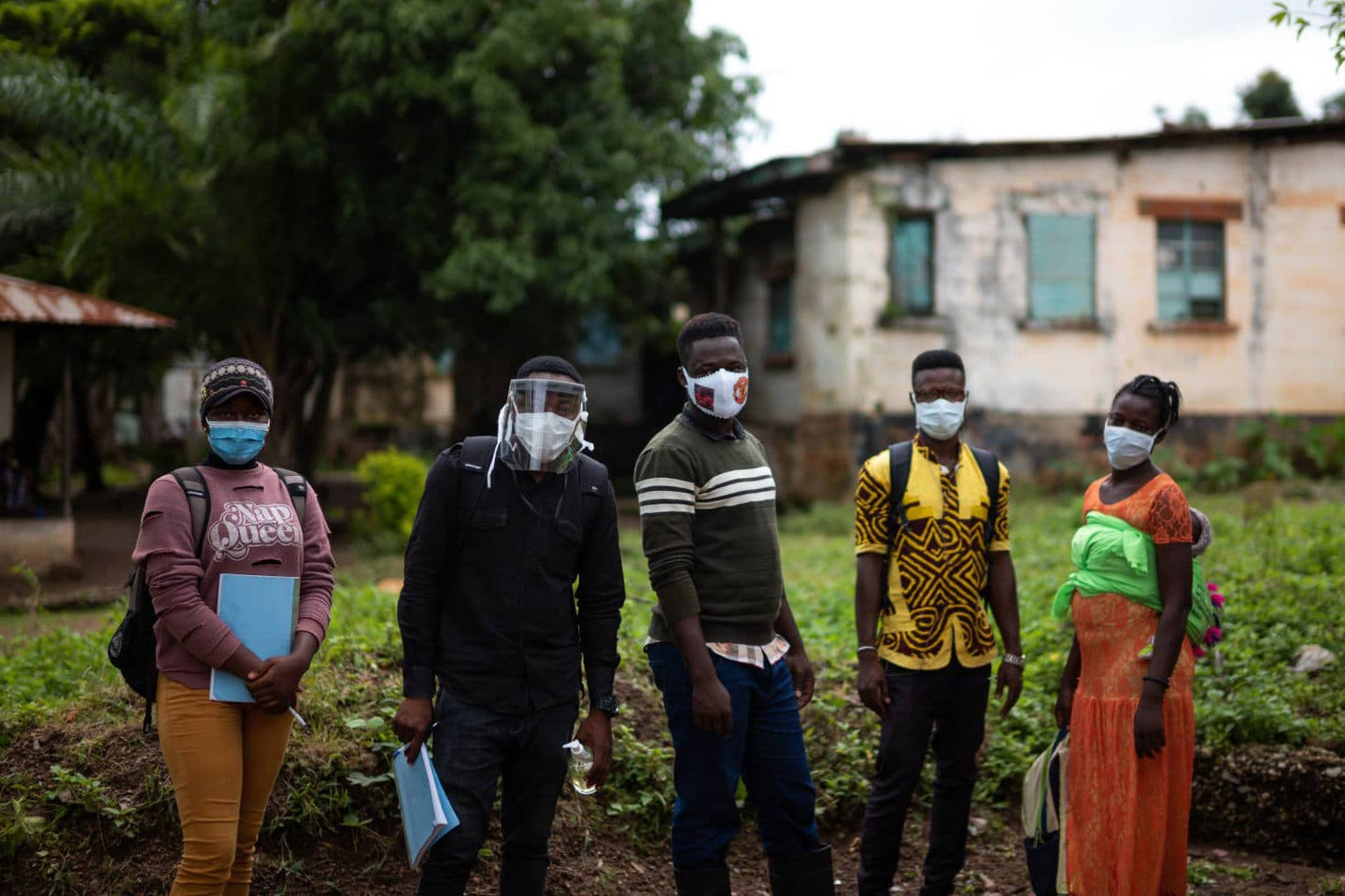 aid workers in Africa go door-to-door to deliver accurate information about Covid-19