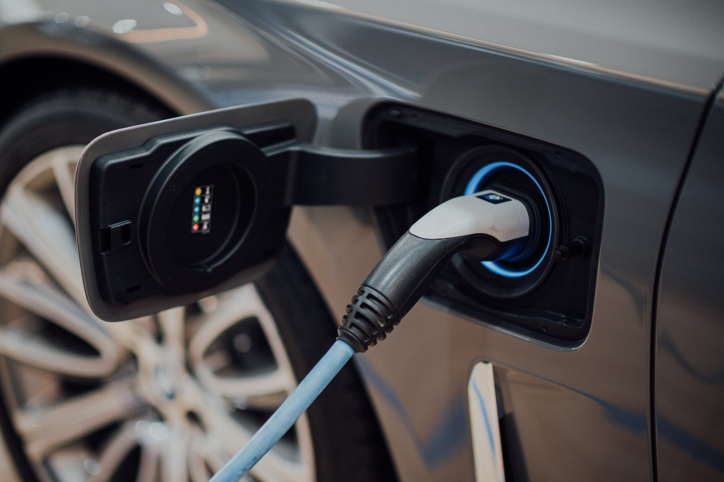 Charging an electric vehicle.