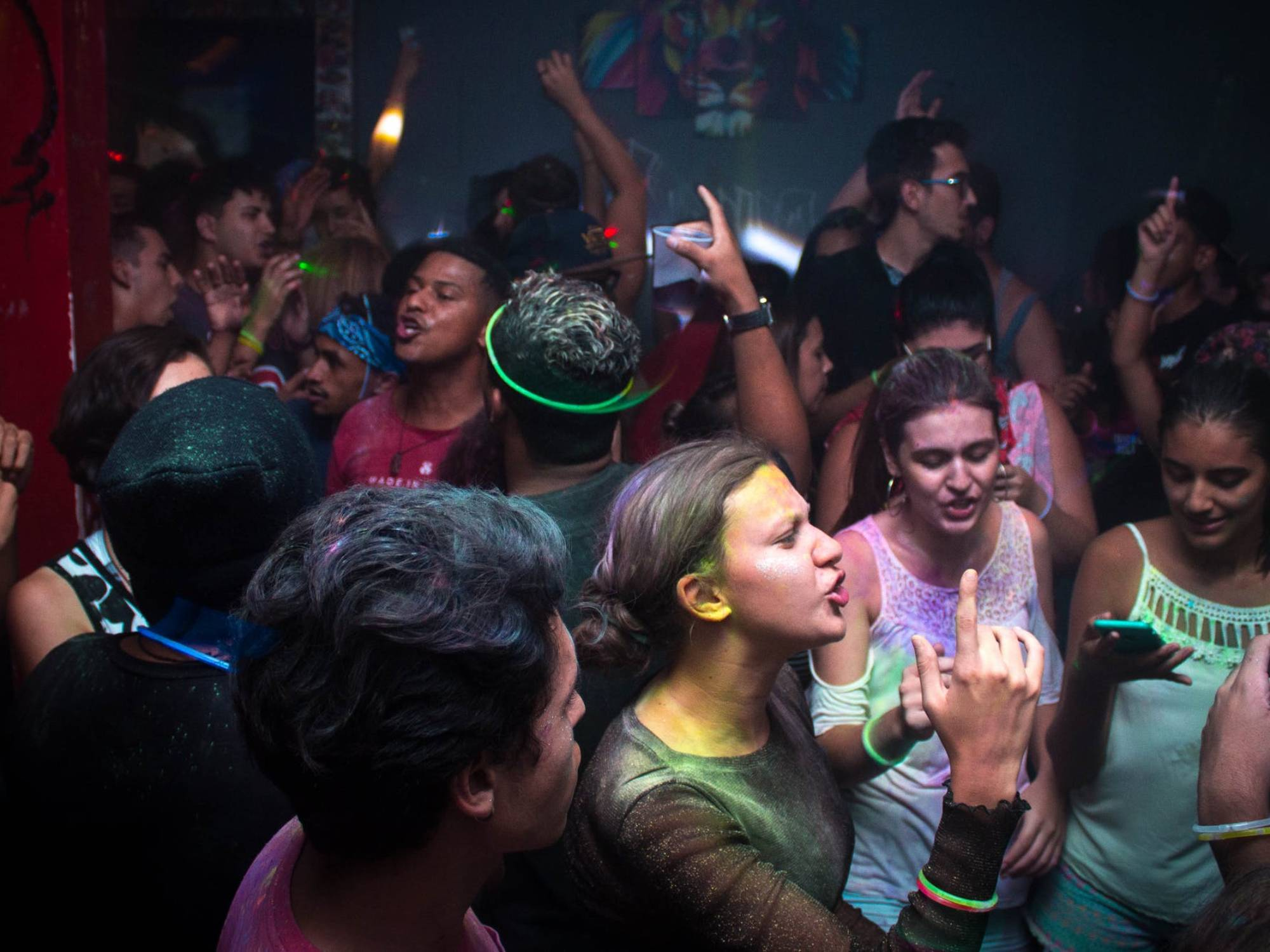 People dancing at house party at night