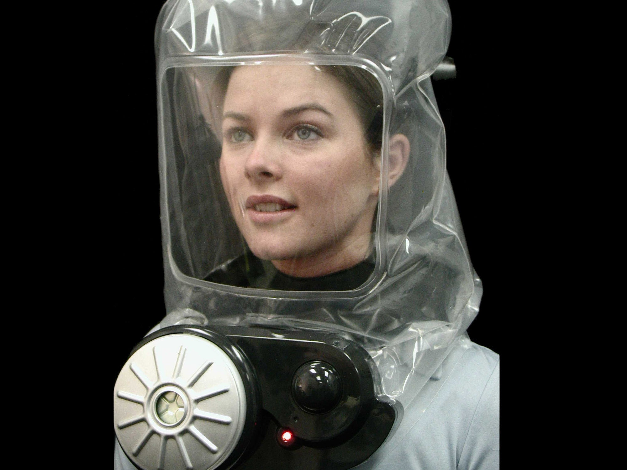 A person wearing an escape hood.