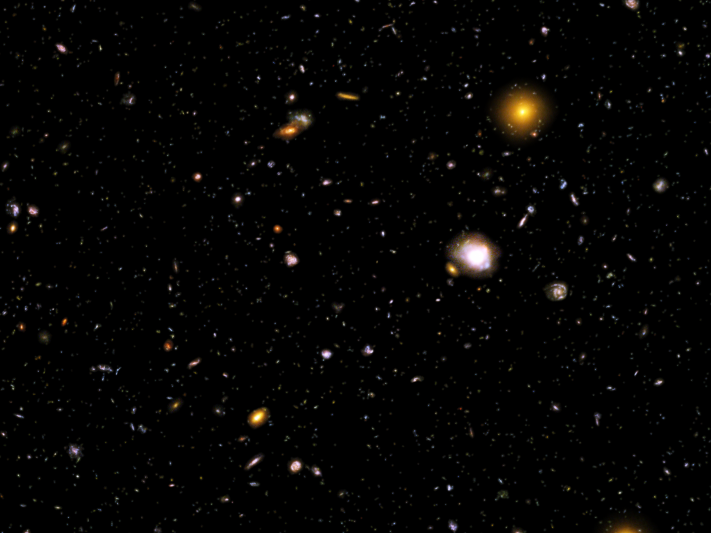 Within this image are thousands of galaxies located many billions of light-years away. Many of these galaxies are too small and too faint to be otherwise seen, but are made visible by the Hubble Space Telescope.