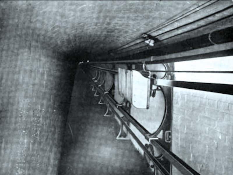 A black and white conveyor belt in a tunnel under the Capitol
