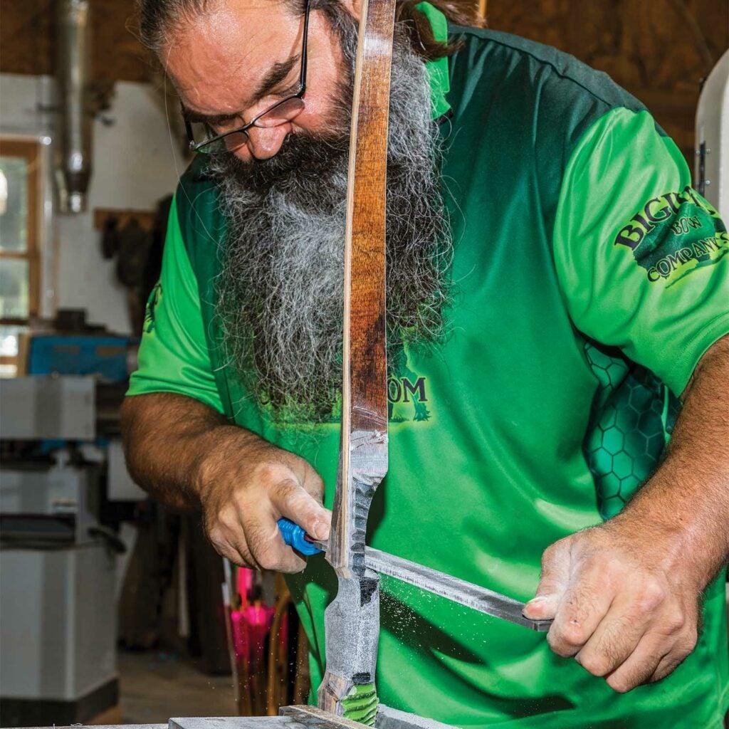 httpspush.fieldandstream.comsitesfieldandstream.comfilesimages20191121-filing-limb-tips-custom-traditional-bow.jpg