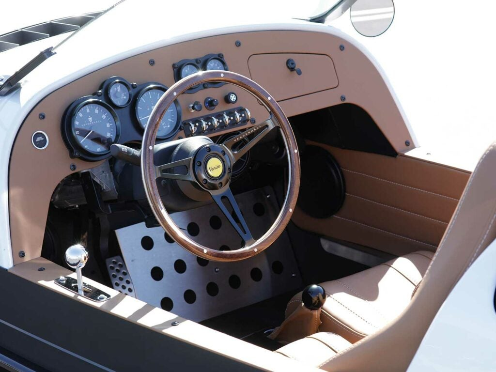We love the not so subtle styling touches of the wood-grain steering wheel and chrome bump shifter.