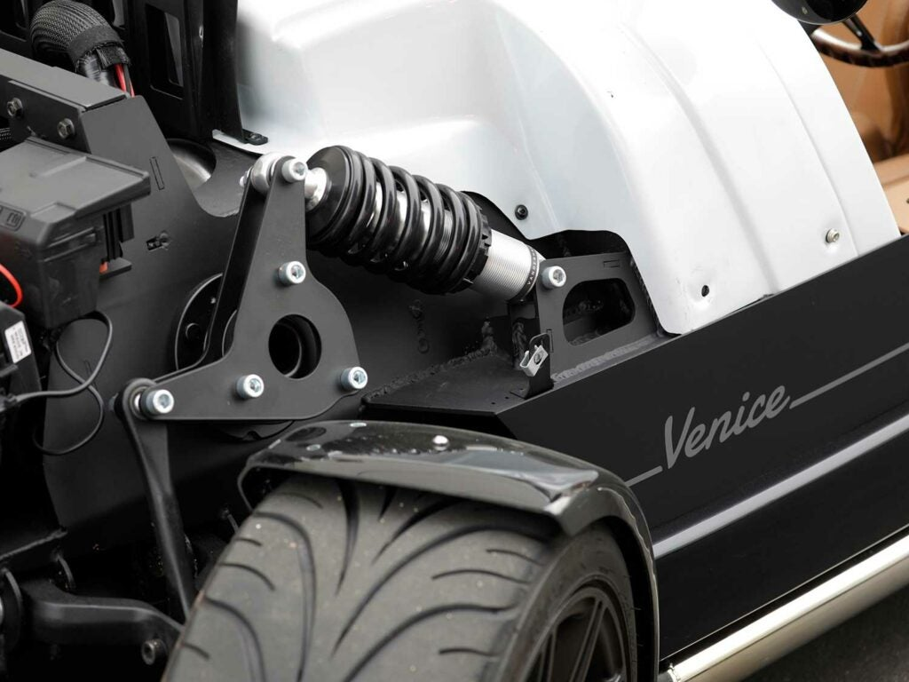 F1-style pushrod suspension makes for a shorter hood line versus a typical MacPherson setup.