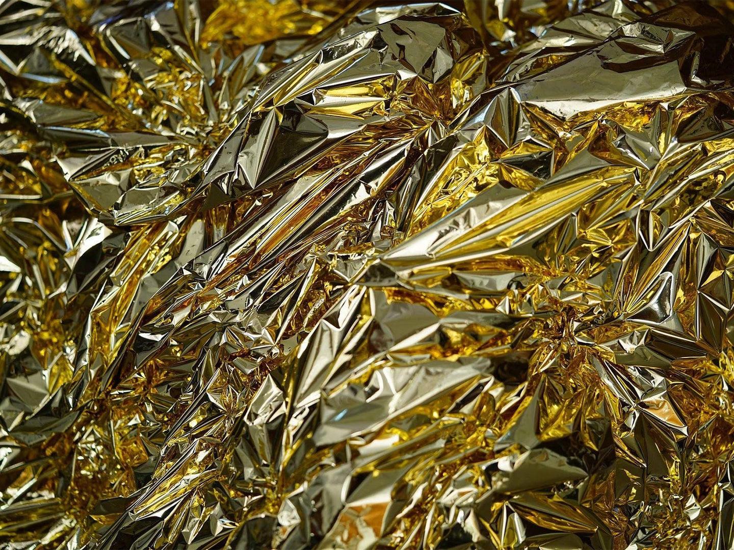 A gold-colored mylar emergency blanket.