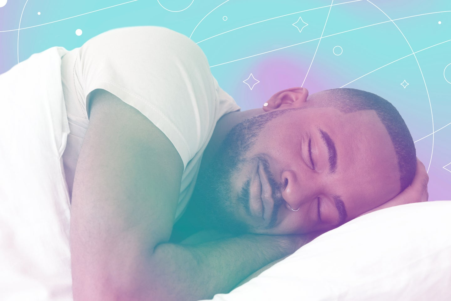 A man sleeping in a bed on a pillow with a white blanket.