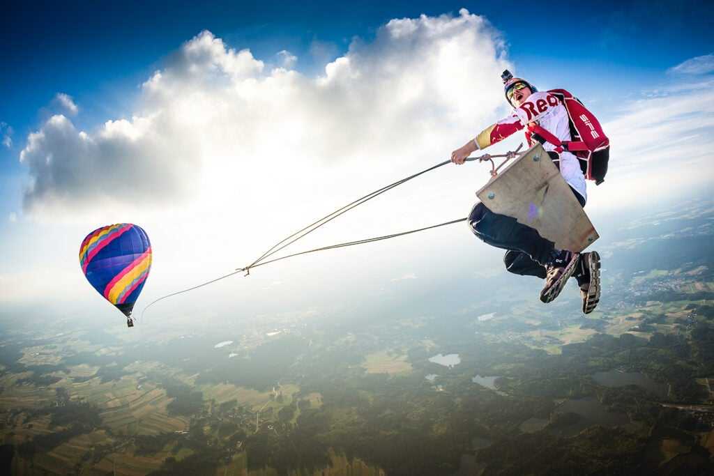 Marco Fürst flying on an unthinkable hot air balloon swing