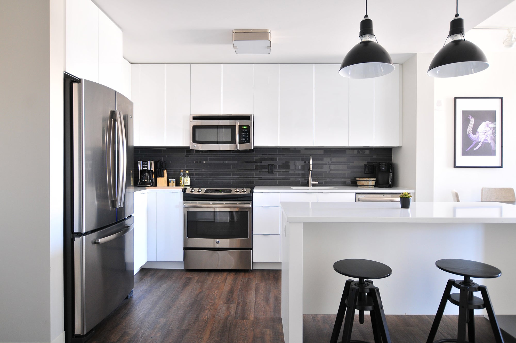 kitchen with stools, an island, and silver appliances