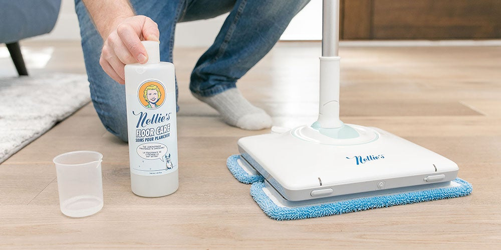 person with mop and cleaner