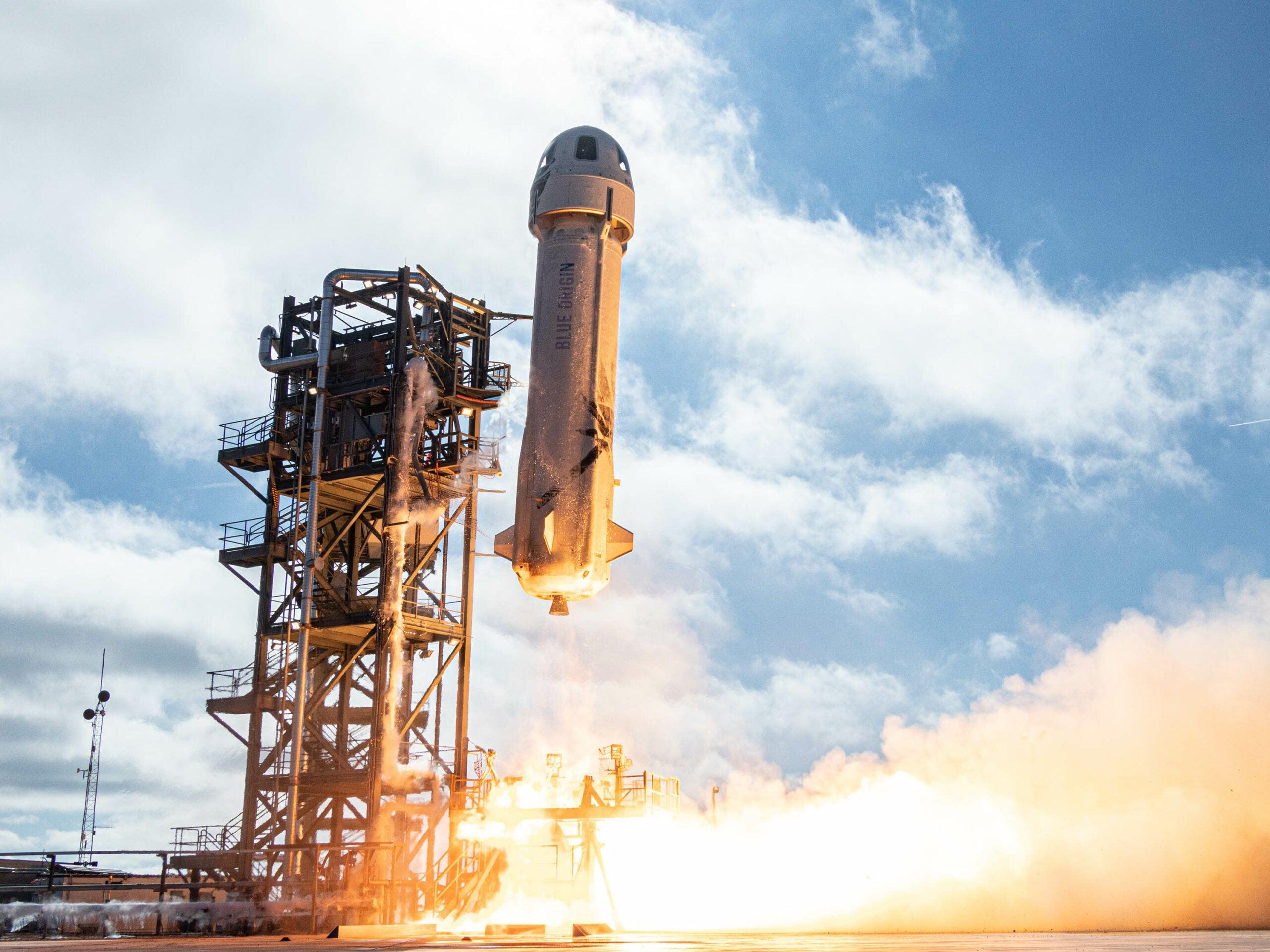 Blue Origin's New Shephard rocket lifts off.