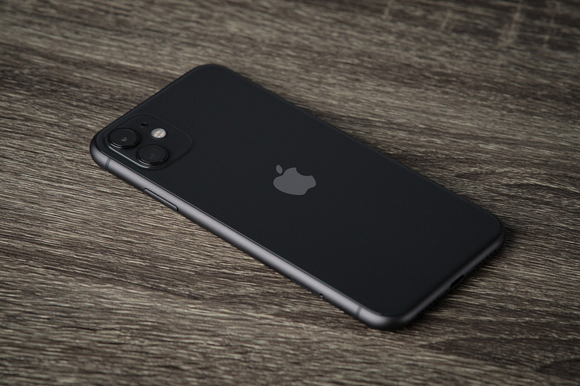 black iPhone on a wood table