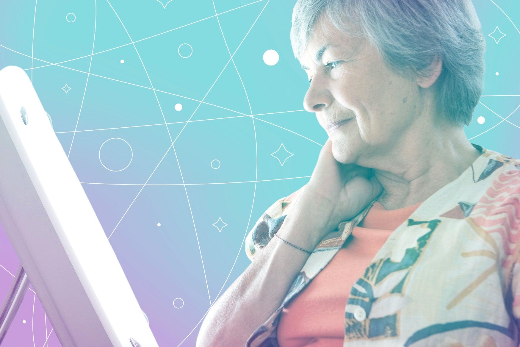 older woman facing a happy lamp