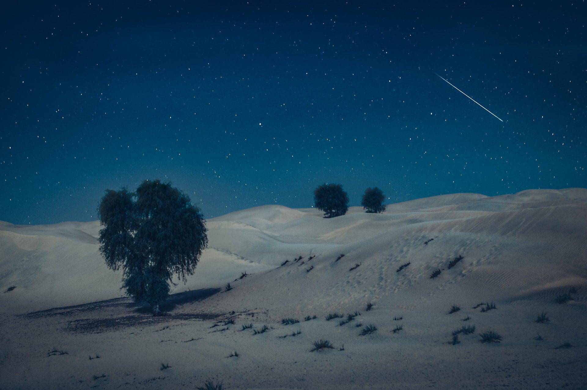 A shooting star in a night scene over the Arabian Desert