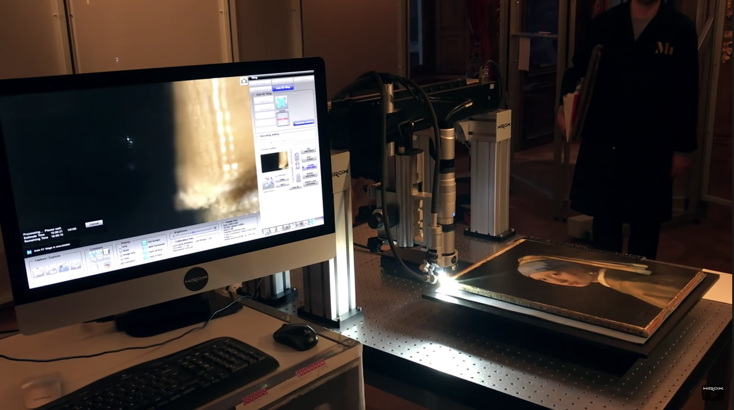 A Hirox digital microscope capturing images of a famous painting.