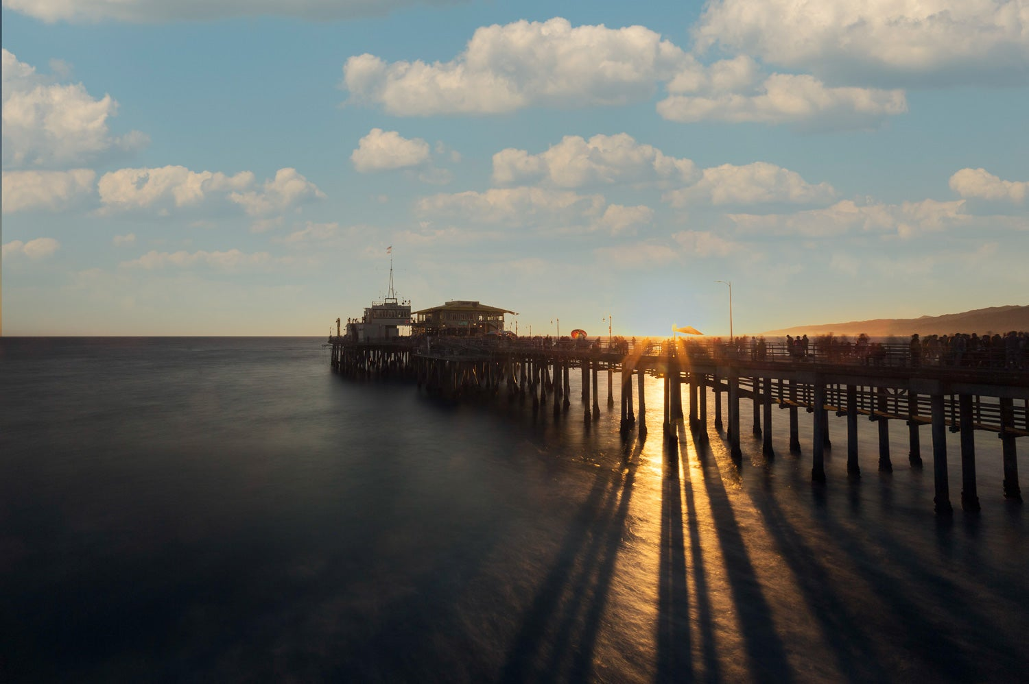 Badly edited photo of a pier during sunset