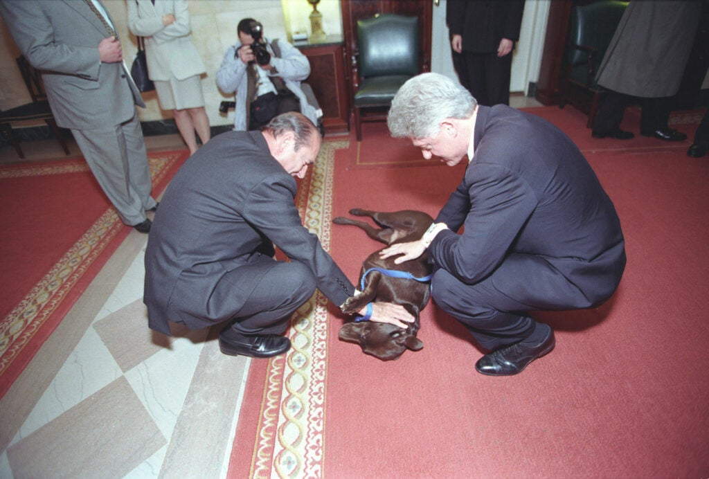 President Clinton and President Chirac of France showing Buddy some love in 1999