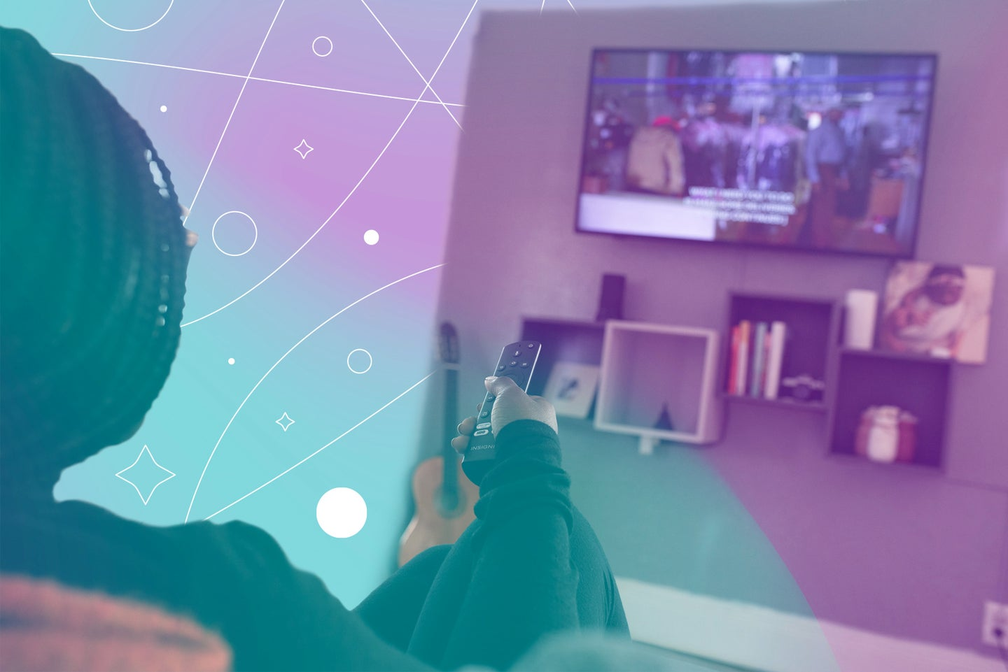 a woman with dark skin and braided hair holds a remote in her hand and points it at a TV on the opposite wall
