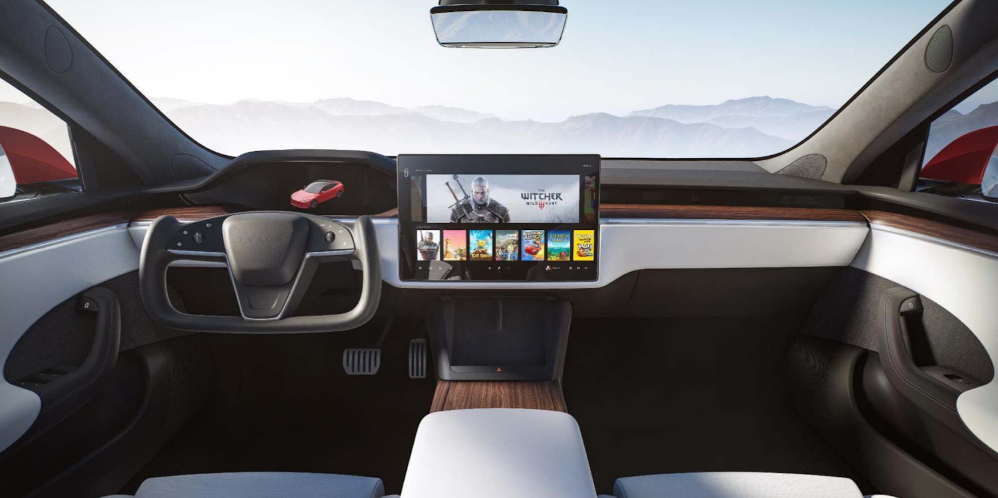 An interior view of the new Tesla Model S, including a yoke-like steering wheel and big center screen.
