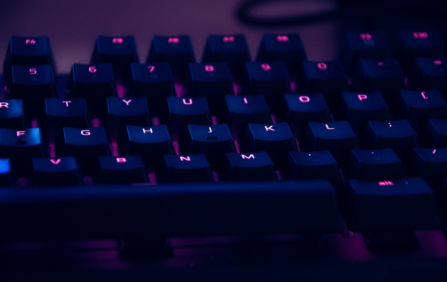 mechanical keyboard with pink and purple lights
