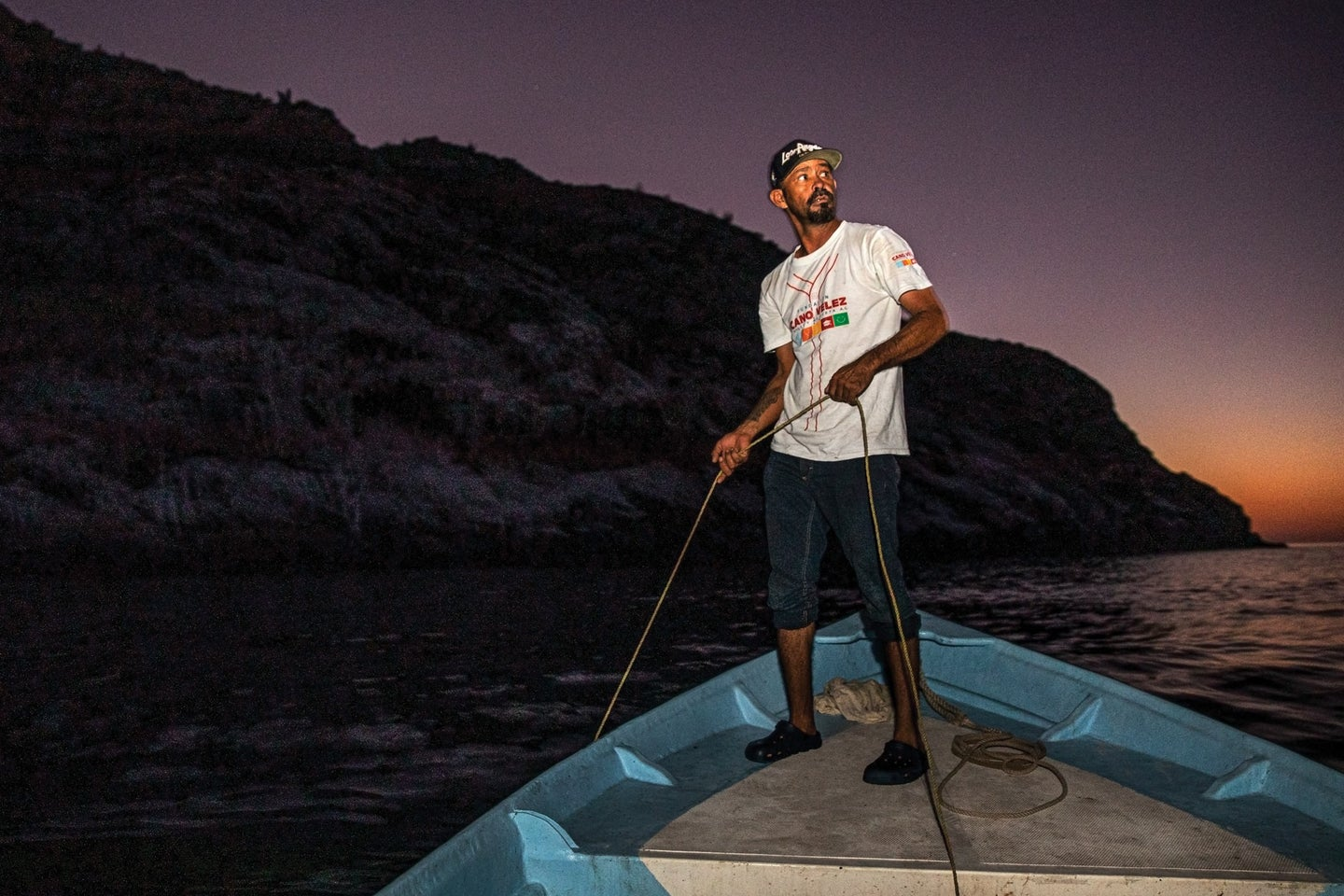 fisherman holding a rope on a boat