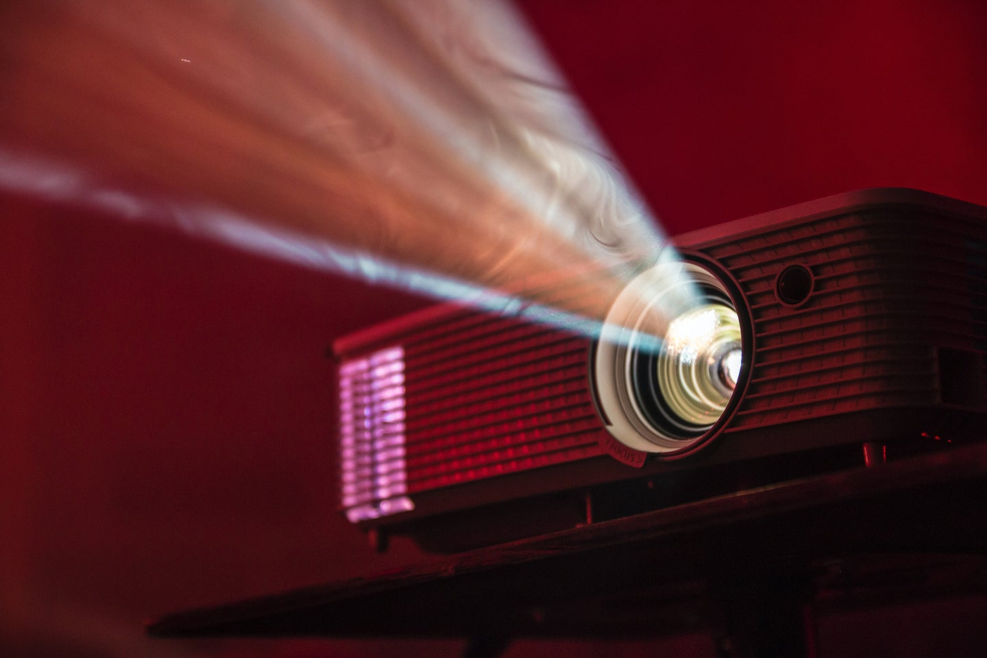 projector in a red room