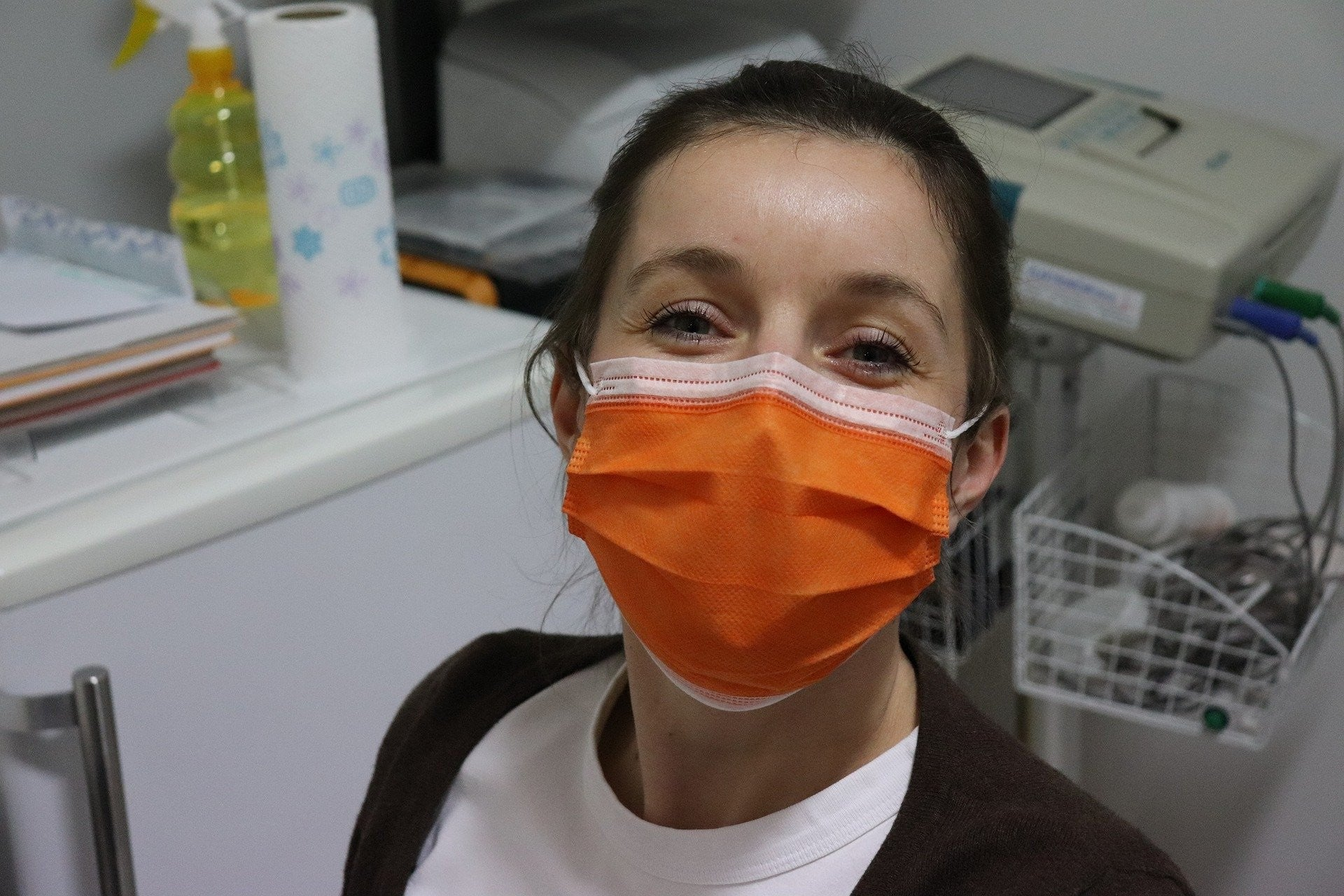 a healthcare worker wearing a surgical mask