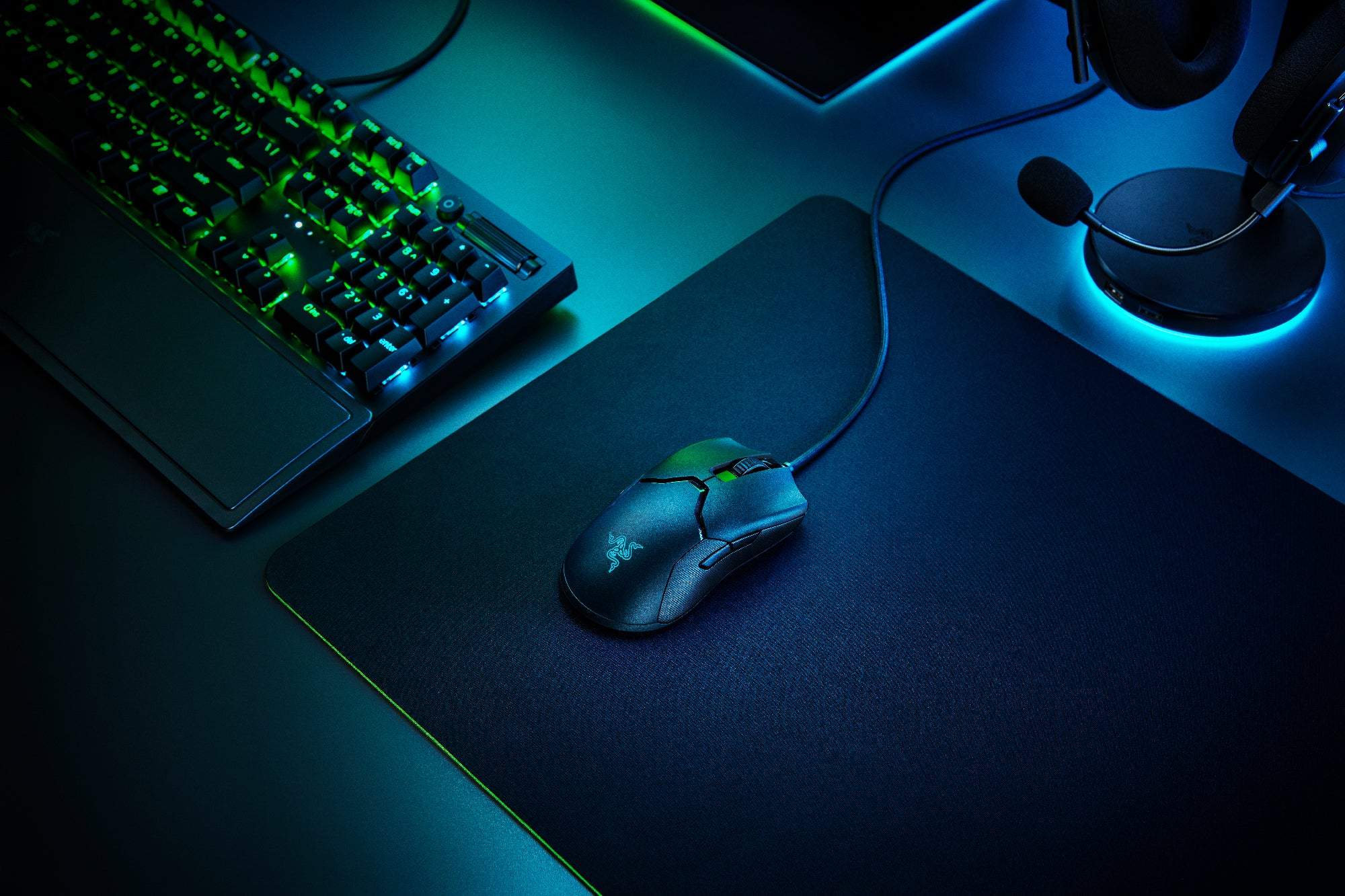 Razer Viper 8K gaming mouse on a desk with a PC.