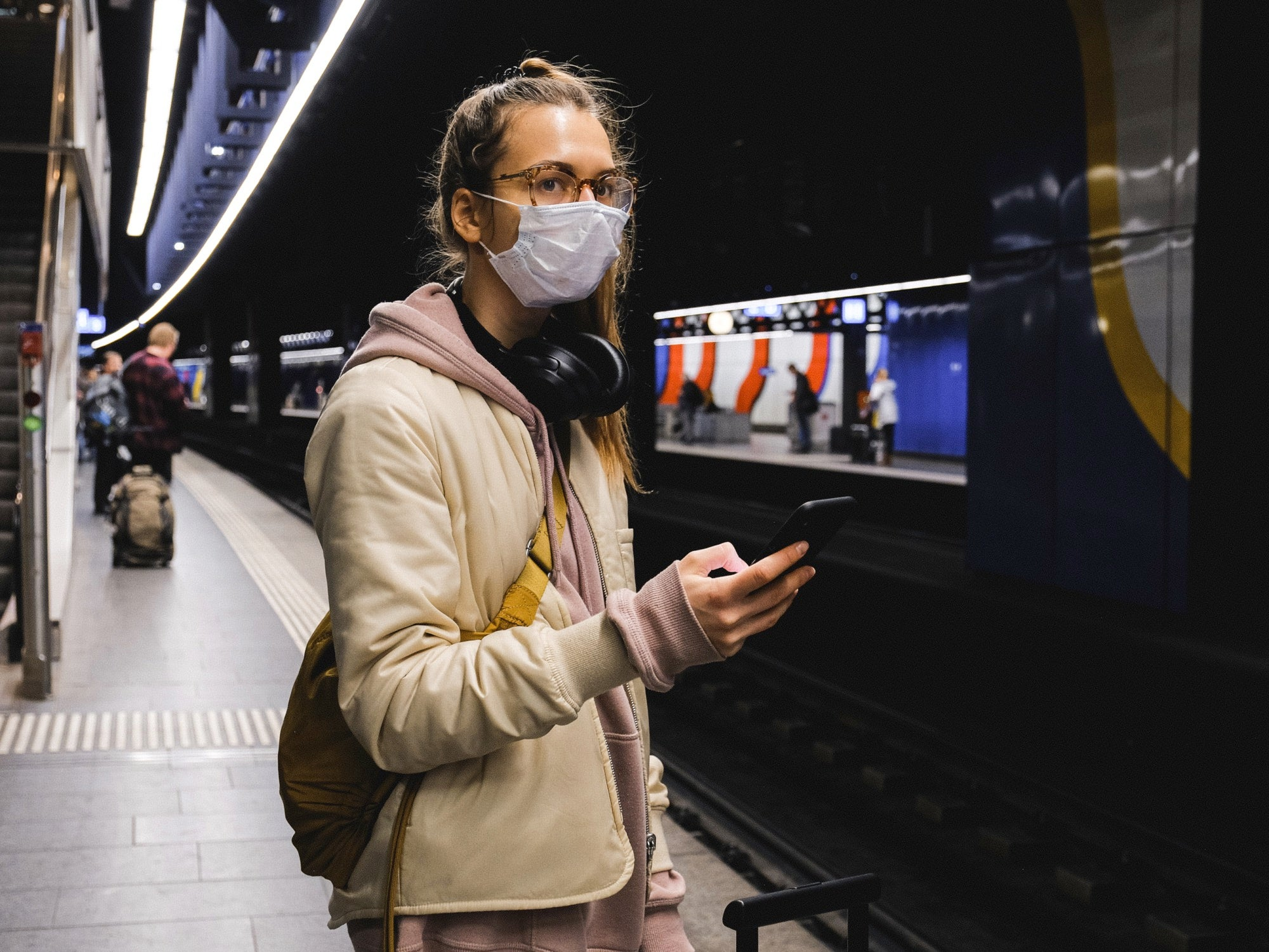 woman wearing mask in subway station