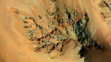 An overhead view of Mars featuring peculiar dark streaks.