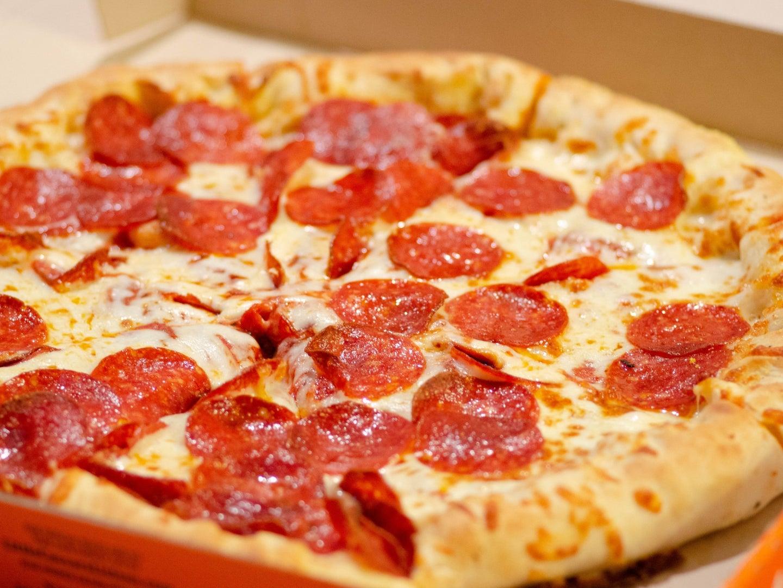 A fresh pepperoni pizza in a pizza box.