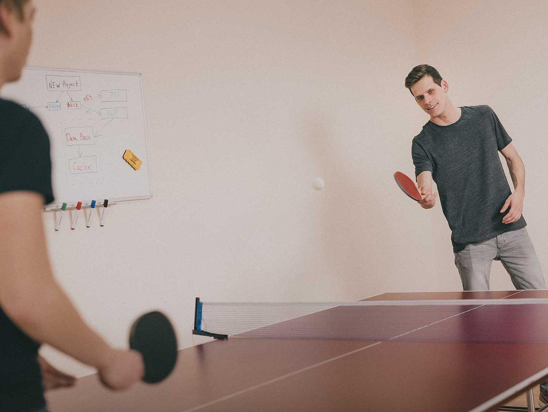 Men playing ping pong.