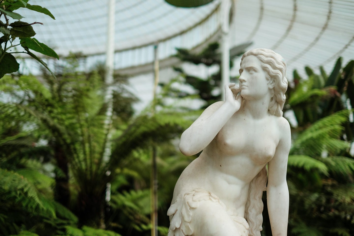 Naked woman statue in garden.
