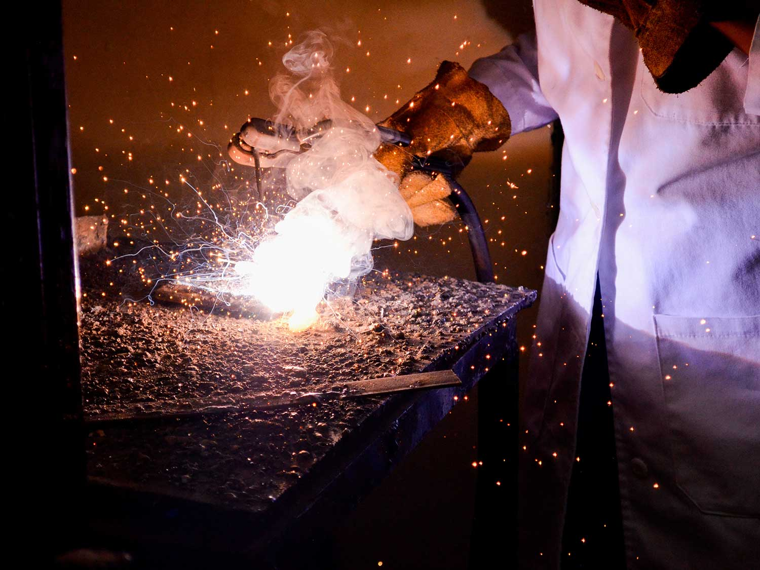 Using welding gloves while welding.