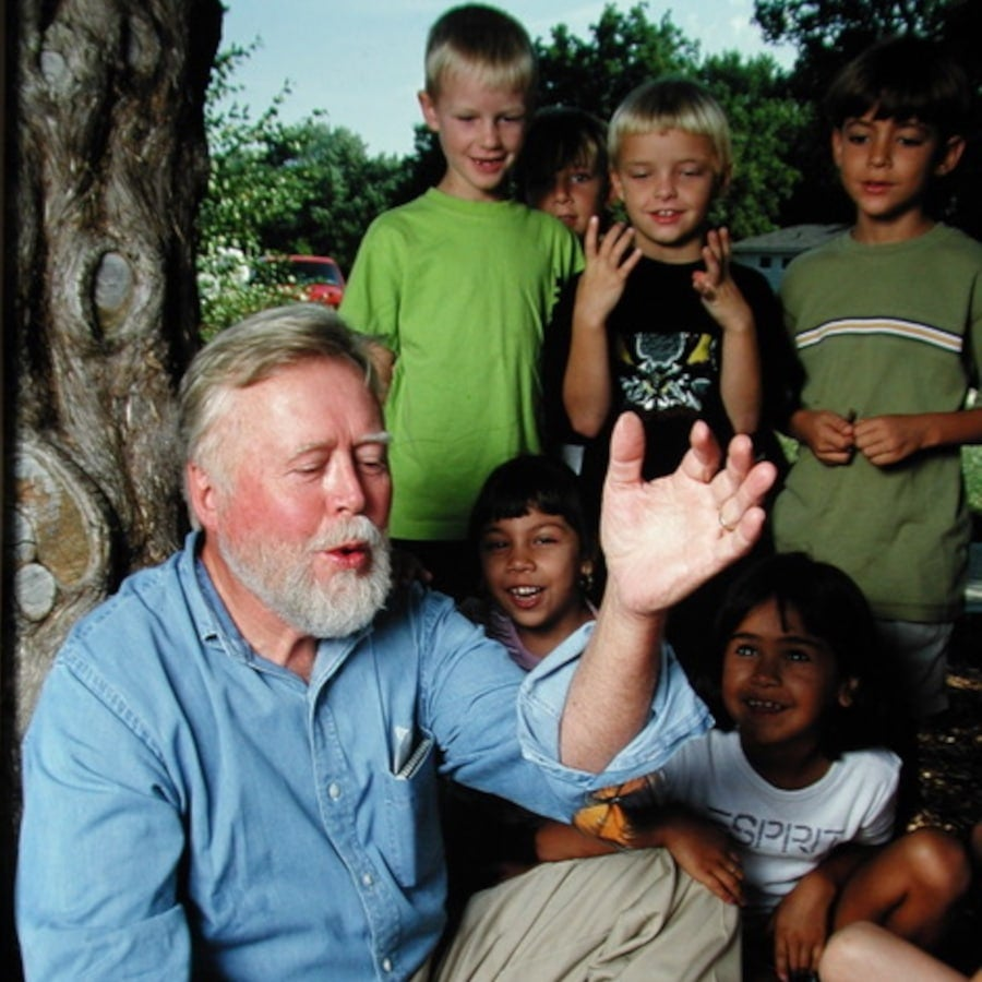 Entomologist Chip Taylor demonstrates tagging and release of a butterfly at a school