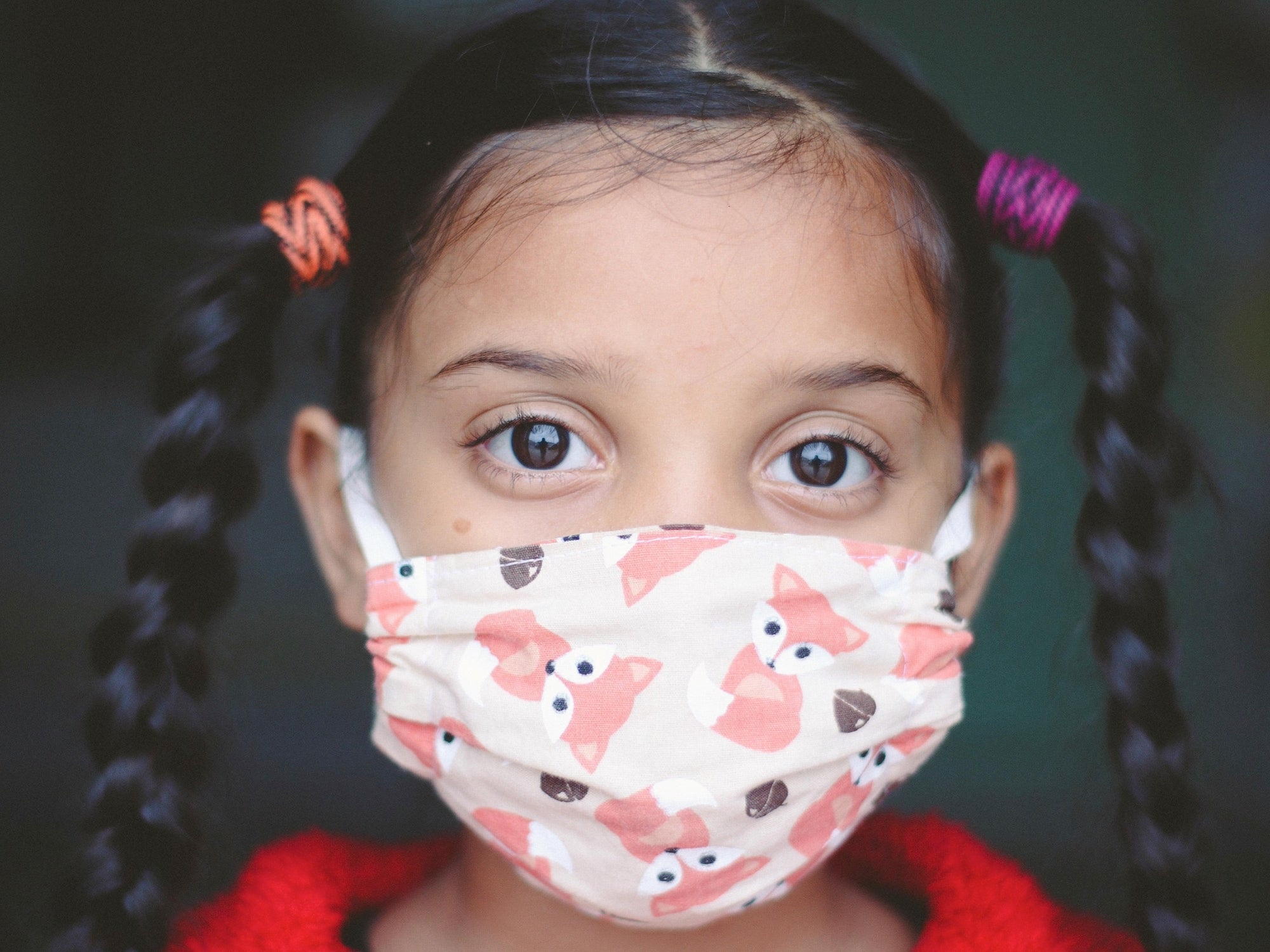 young girl wearing covid-19 mask