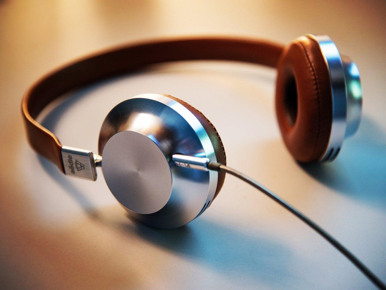 Vintage looking chromed headphones on a table.