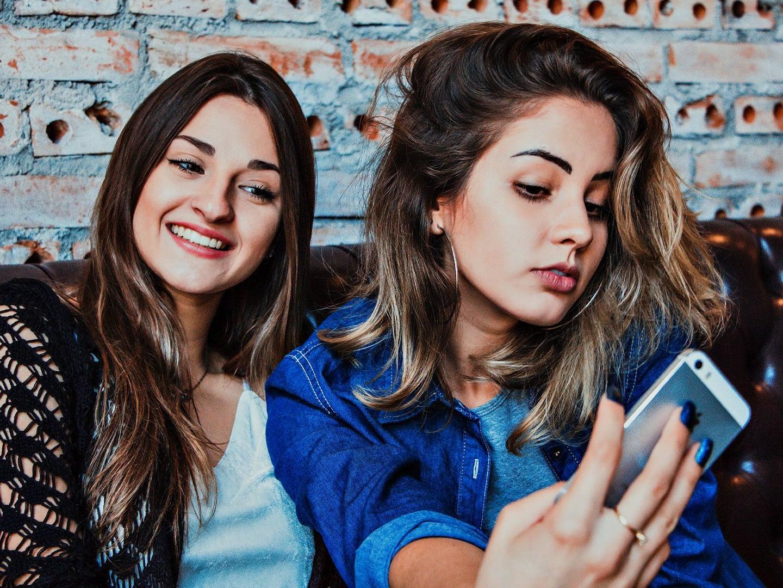 Two friends taking a selfie.