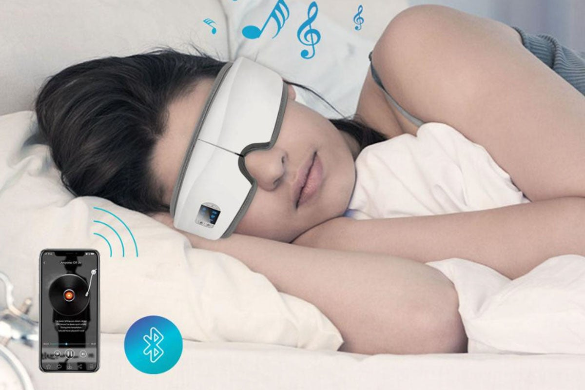 woman sleeping with an eye massager on