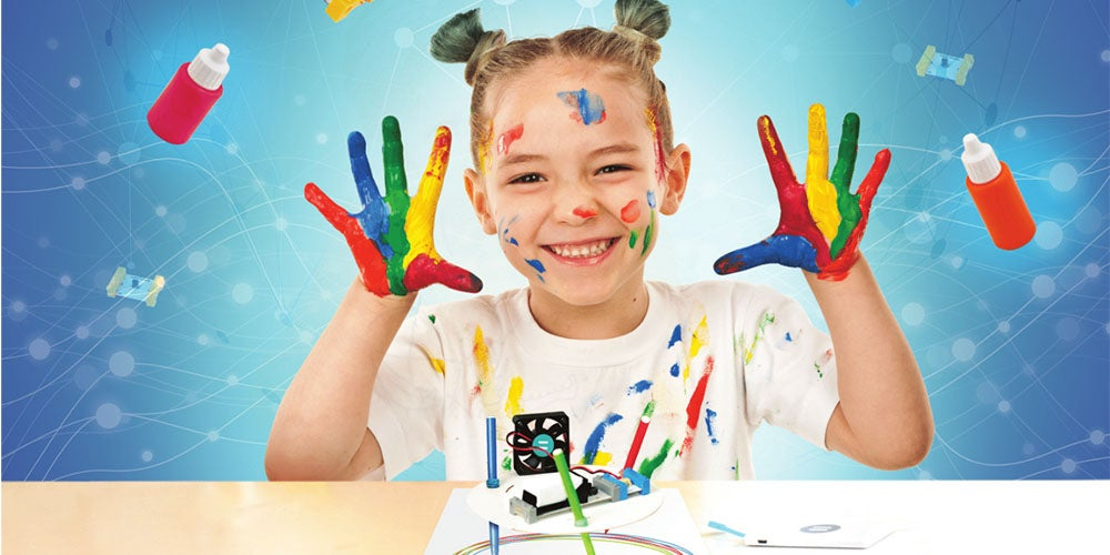 girl with finger paint on her hands