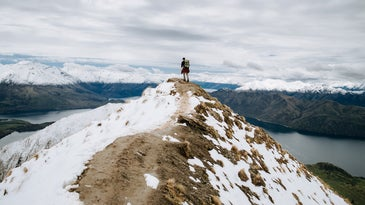 person on top of a snowy mountain top wearing the best snow boots