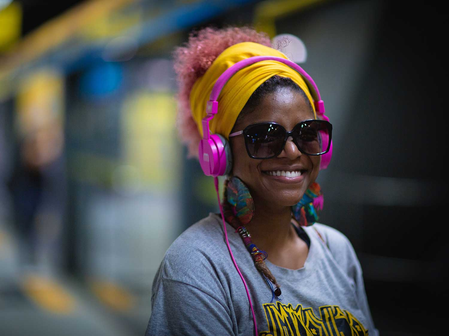 Woman listening to music through over-ear headphones.