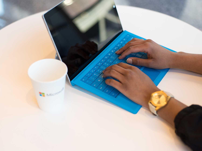Typing on laptop.
