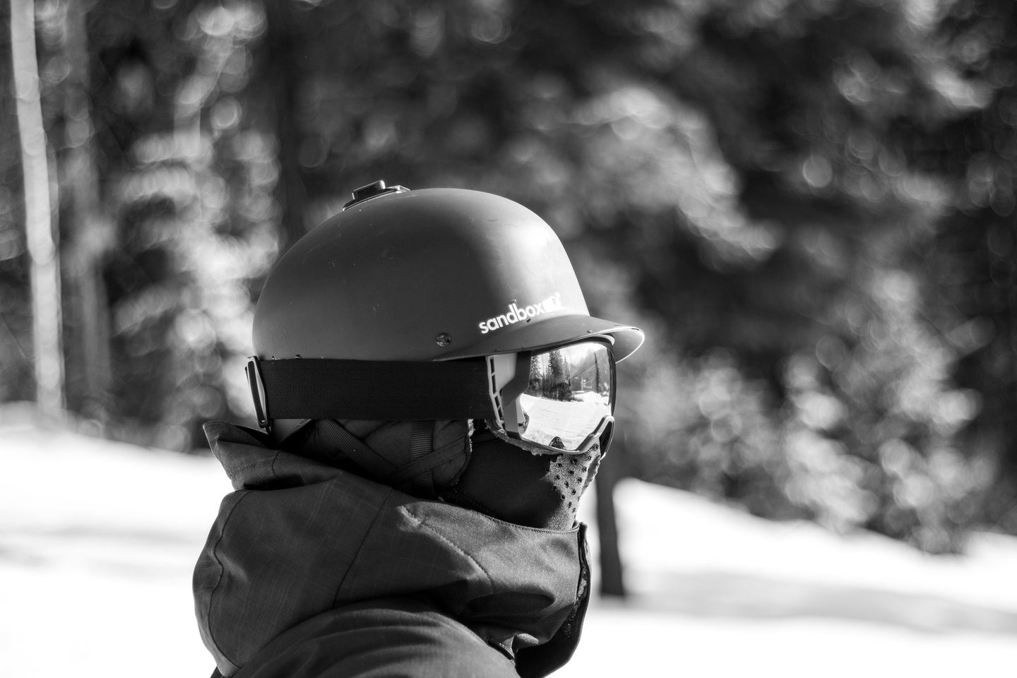 person with a helmet, ski goggles, the best ski mask, and jacket on a mountain
