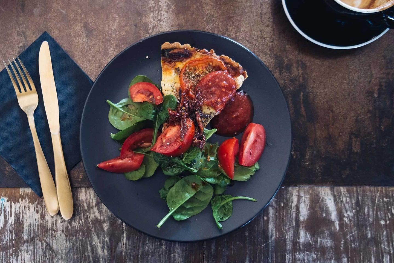Pretty food on a black plate