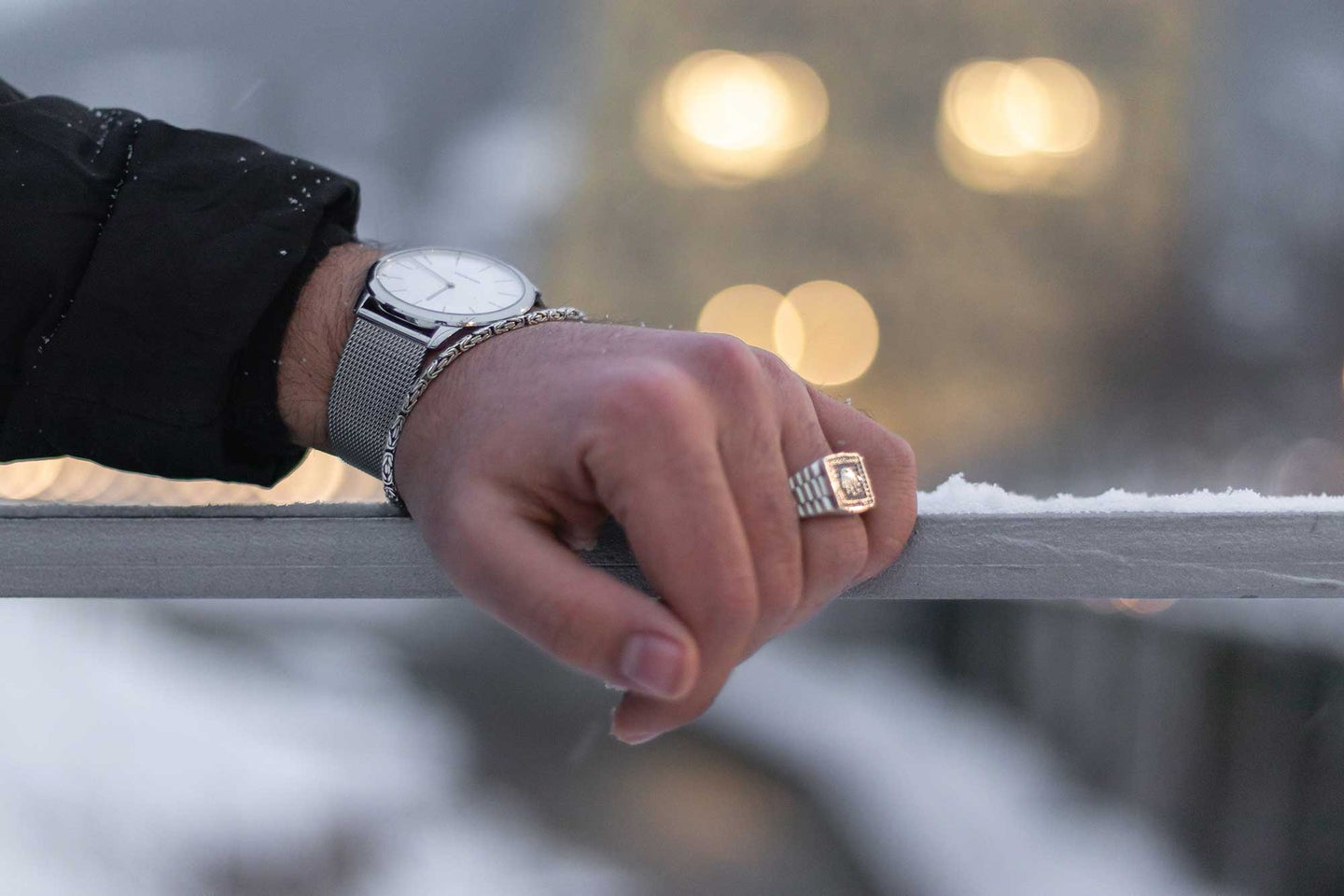 Man leaning against a cold snowy railing