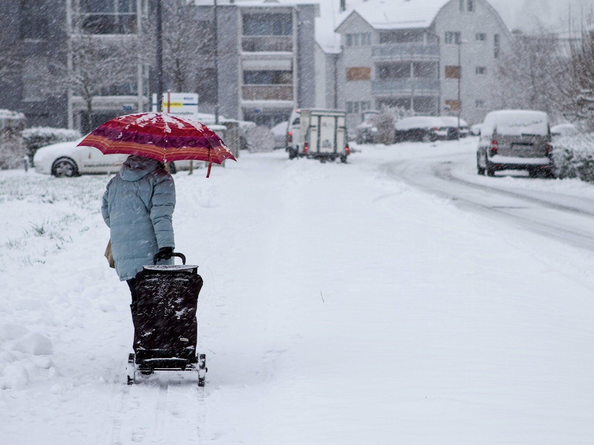 person walking in snowy street